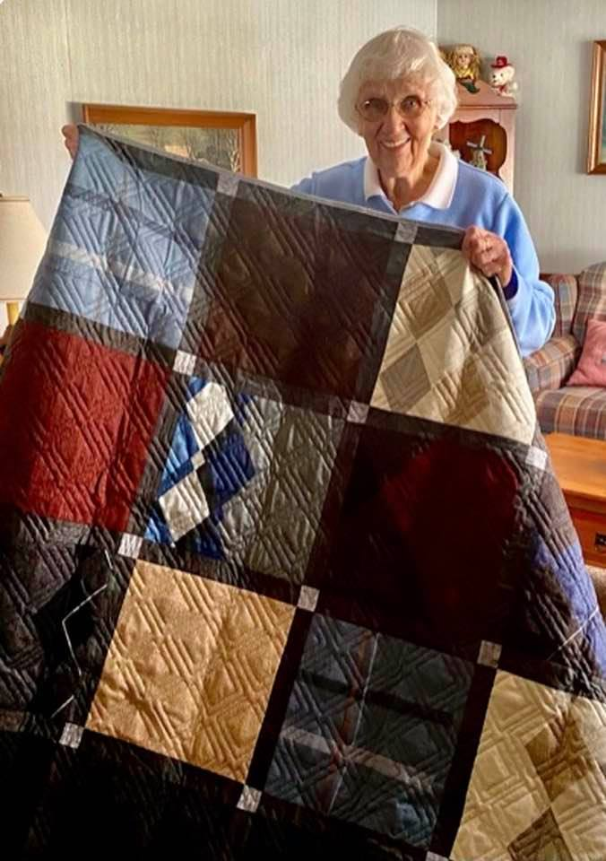 This quilt was made out of fine knit sweaters. Gloria absolutely loves her quilt. No one can bring her husband back, but she treasures this quilt with his sweaters.